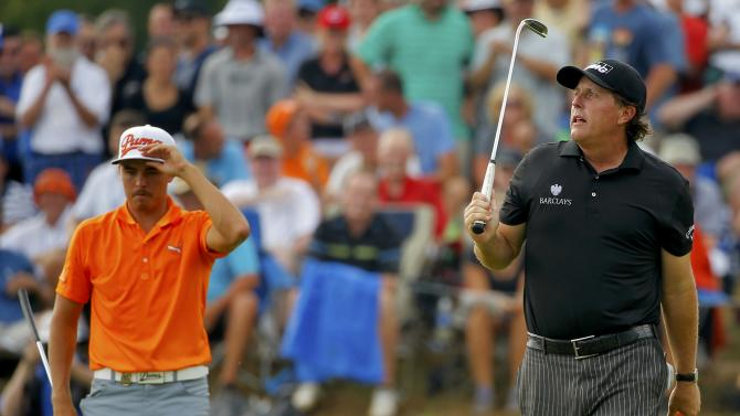 Fowler and Mickelson walk on the seventh hole during the final round of the 2014 PGA Championship at Valhalla Golf Club in Louisville