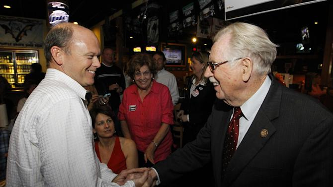 FILE - In this April 3, 2012 file photo, Rep. Roscoe Bartlett, R-Md., right, shakes hands with Terry Allen  as he awaits the primary election results in Frederick, Md. With Election Day less than six weeks off, Democrats and Republicans dueling for House control are focusing on poll-tested themes to launch attacks on each other. Yet even as Republicans warily gauge the impact Mitt Romney's recent campaign struggles might have on House races, the outlook seems essentially unchanged: Democrats may gain a few seats and perhaps do a bit better than was expected weeks ago, but seem unlikely to grab the added 25 seats they need to take over the chamber.    (AP Photo/Luis M. Alvarez, File)