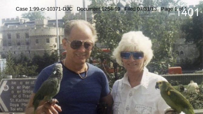 "This undated photo filed in federal court documents in Boston by defense attorneys for James ""Whitey"" Bulger on Wednesday, July 31, 2013, shows Bulger with an unidentified woman holding birds in an unknown location. The photo was among several that showed a softer side of Bulger, which prosecutors complained were an attempt to salvage his reputation. Bulger, 83, is charged in a racketeering indictment with playing a role in 19 killings and multiple extortions during the 1970s and '80s when he alleged led the Winter Hill Gang. (AP Photo/Federal Court Documents)"