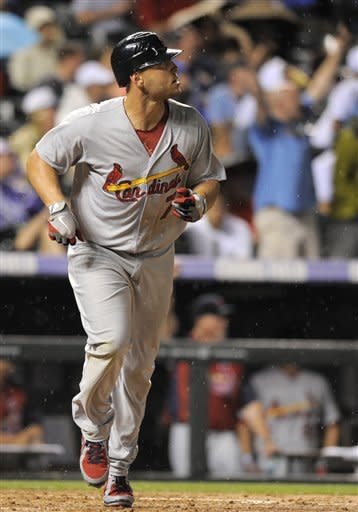Holliday hits 2 homers as Cardinals beat Rockies