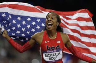USA's Sanya Richards-Ross reacts after winning the women's 400-meter during the athletics in the Olympic Stadium at the 2012 Summer Olympics, London, ...