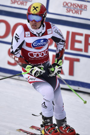 Austria's Marcel Hirscher reacts in the finish area after the first run of the men's giant slalom race at the alpine skiing World Cup finals in Lenzerheide, Switzerland, Saturday, March 15, 2014. (AP Photo/Keystone, Peter Schneider)