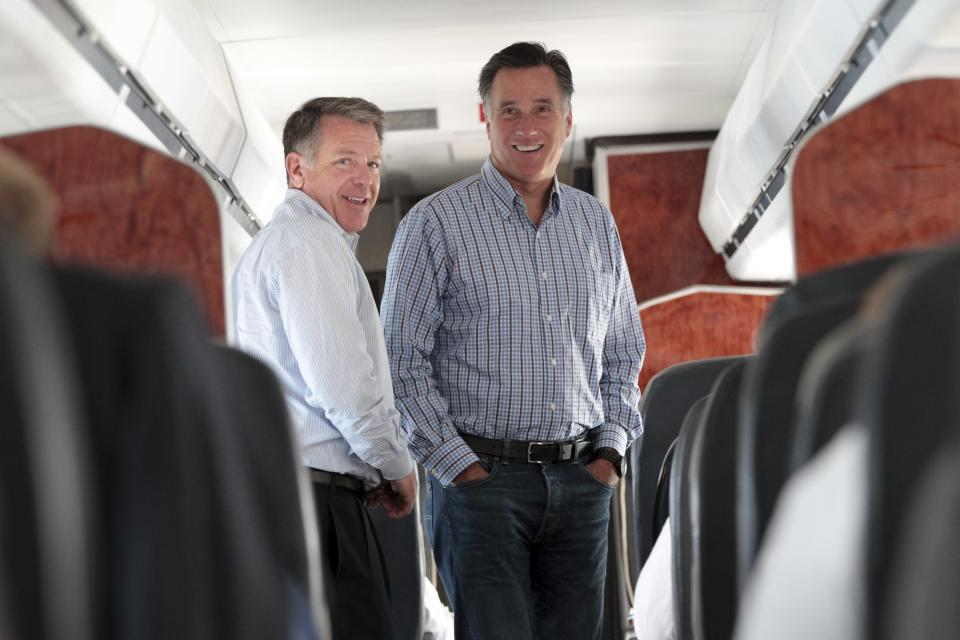 Republican presidential candidate, former Massachusetts Gov. Mitt Romney,  left, speaks to Bob White on the campaign charter flight between Boston and Norfolk, Va., Friday, Aug. 10, 2012.  (AP Photo/Mary Altaffer)