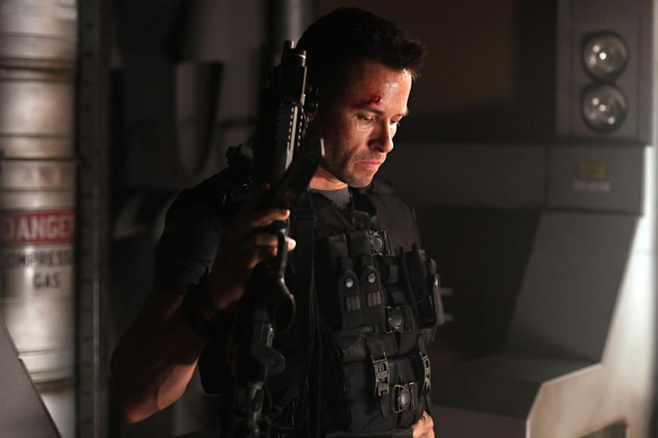 "In this film image released by Film District, Guy Pearce is shown in a scene from ""Lockout."" (AP Photo/Film District)"