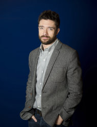 In this April 16, 2012 photo, actor Topher Grace poses for a portrait in New York. Grace stars in the off Broadway play &quot;Lonely, Im Not&quot; and an independent film called &quot;The Giant Mechanical Man.&quot; (AP Photo/Charles Sykes)