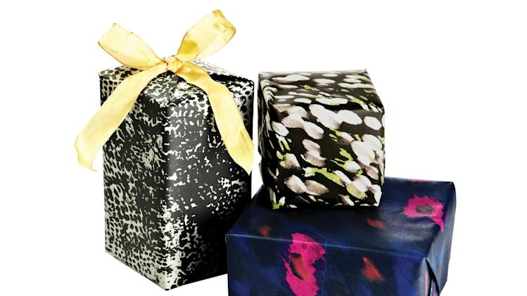 This product image released by One Kings Lane shows gift-wrapped boxes with paper designed by stylist-designer Rachel Zoe. Zoe is among the tastemakers that partnered with the site for the One Kings Lane Holiday Charity Series. (AP Photo/One Kings Lane)