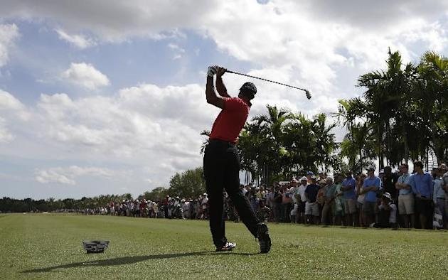Tiger Woods hits from the sixth tee during the final round of the Cadillac Championship golf tournament on Sunday, March 9, 2014, in Doral, Fla