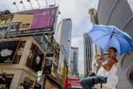&lt;p&gt;A man is seen sitting in the shade of his umbrella in front of high rise buildings in Hong Kong, on September 14. Asia must fight complacency and transform its economic and social models if it is to keep driving global growth in years to come as Europe and the United States slow, experts say.&lt;/p&gt;