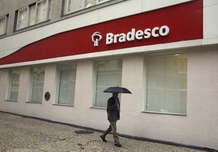 A man walks past a Banco Bradesco branch in downtown Rio de Janeiro