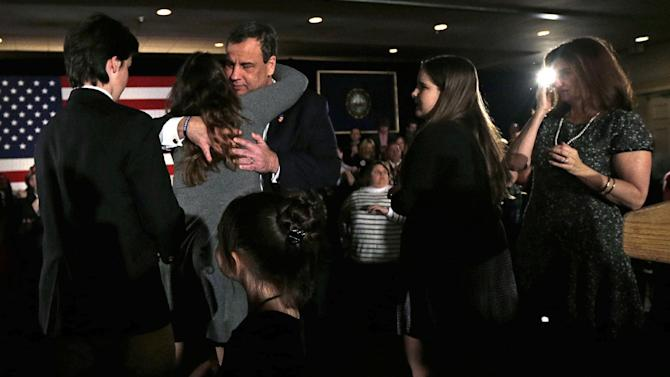 Republican presidential candidate, New Jersey Gov. Chris Christie embraces his children during a primary night rally in Nashua, N.H., Tuesday, Feb. 9, 2016. (AP Photo/Charles Krupa)