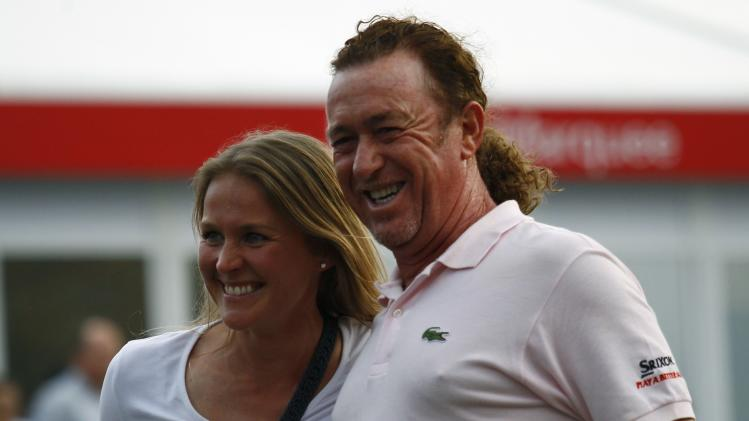 Jimenez of Spain smiles with girlfriend Styblo after winning the European Tour Hong Kong Open golf tournament