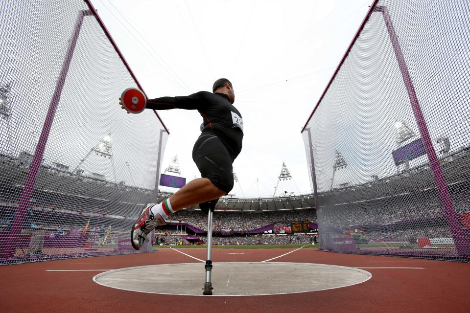 Bulgaria's Dechko Ovcharov spins to make a throw in the Men's Discus Throw - F42 category during the athletics competition at the 2012 Paralympics, Sunday, Sept. 2, 2012, in London.  (AP Photo/Matt Dunham)