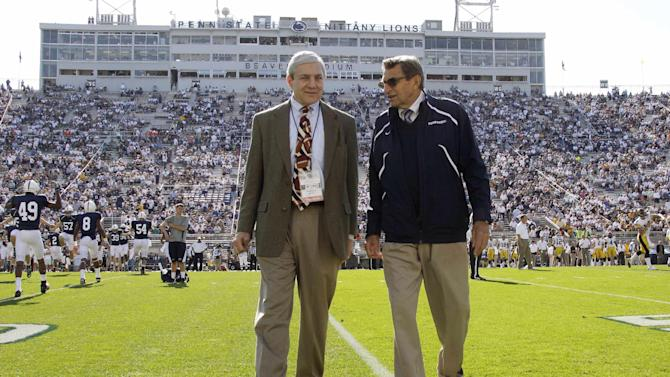 File - In this Oct. 8, 2011, file photo Penn State president Graham Spanier, left, and head football coach Joe Paterno chat before an NCAA college football game against Iowa in State College, Pa. As Penn State tries to move past the scandal after Sandusky's trial, the devastating Freeh Report and unprecedented NCAA penalties, Title IX remains a potential long-term legal problem. The reason: Not only have Title IX lawsuits produced some of the most expensive judgments against universities in recent years, but the law allows for the possibility, however unlikely, that a university's access to all federal dollars could be cut off. (AP Photo/Gene Puskar, File)
