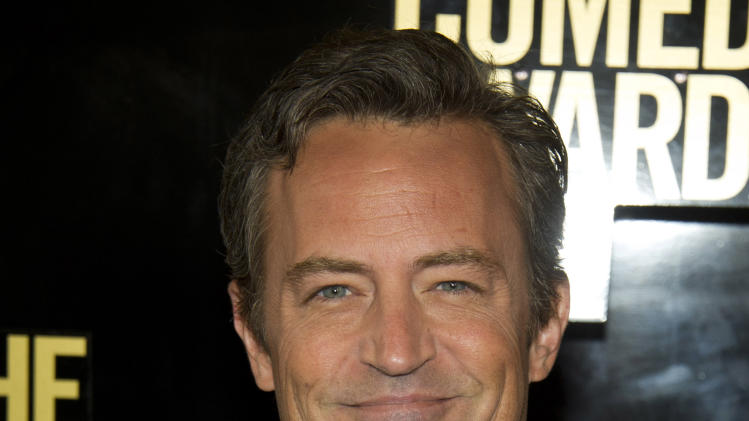 "FILE - In this April 28, 2012 file photo, Matthew Perry arrives to The 2012 Comedy Awards in New York. Hoping to lure viewers with laughs, struggling NBC is calling on old friend Matthew Perry to lend a hand. The TV network unveiled a fall schedule on Sunday that has 10 sitcoms, double the number of dramas it will air, including ""Go On,"" starring Perry as a fast-talking, sarcastic sportscaster who loses his wife in a car accident. (AP Photo/Charles Sykes, File)"