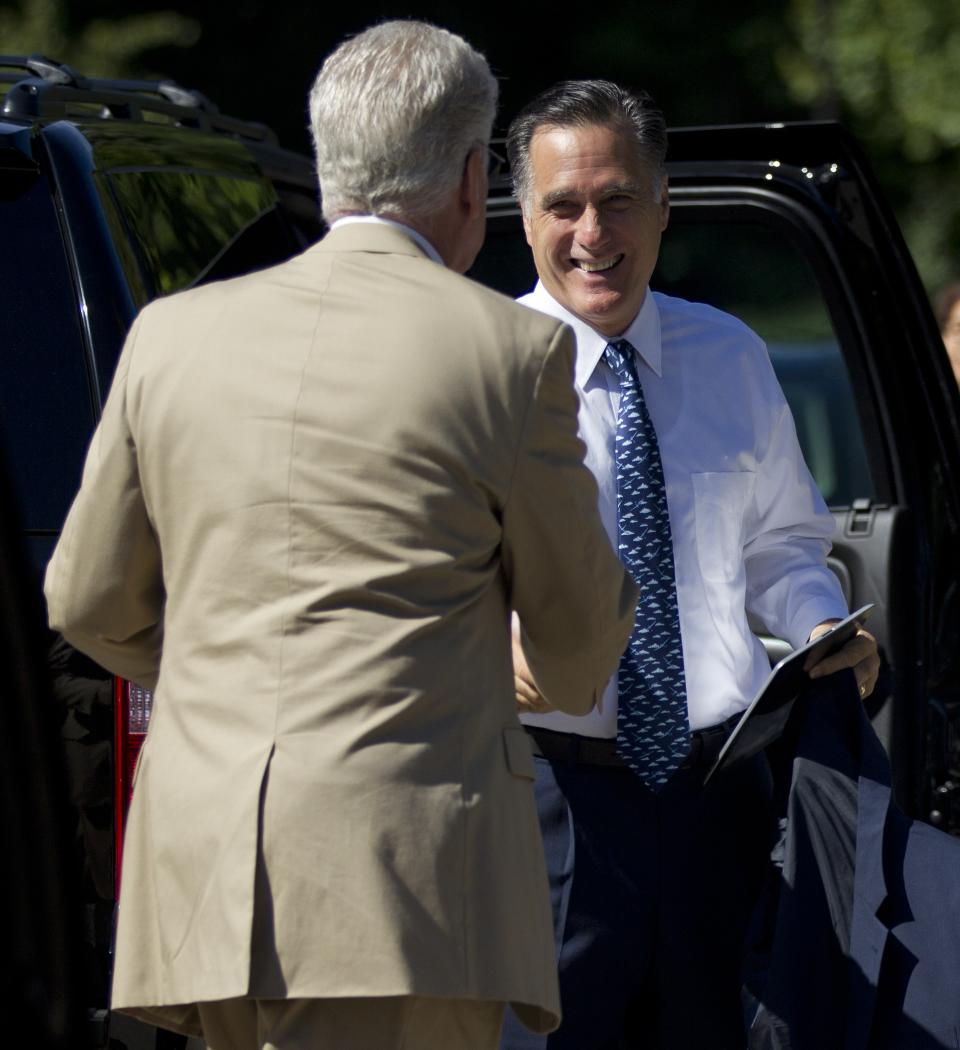 Republican presidential candidate, former Massachusetts Gov. Mitt Romney, right, greets a bystander before entering the Church of Jesus Christ of Latter-day Saints on Sunday, Aug. 19, 2012, in Wolfeboro, N.H.  (AP Photo/Evan Vucci)