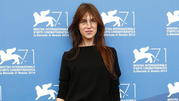 """Actress Gainsbourg poses during the photo call for the movie """"3 Coeurs"""" at the 71st Venice Film Festival"""