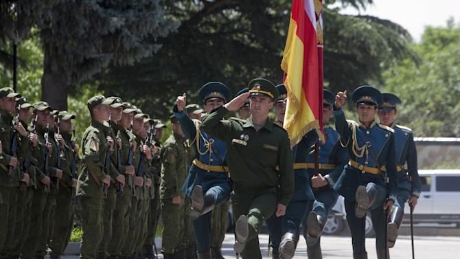 Servicemen of the military forces of South Ossetia march during an oath of allegiance ceremony in Tskhinvali