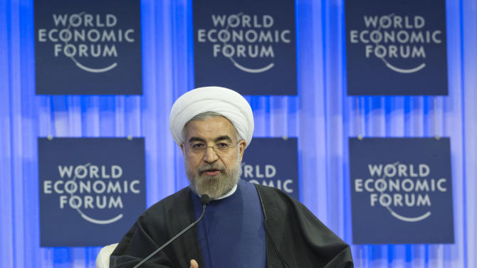 Iranian President Hassan Rouhani gestures as speaks during a session of the World Economic Forum in Davos, Switzerland, Thursday, Jan. 23, 2014. Leaders gathered in the Swiss ski resort of Davos have made it a top priority to push to reshape the global economy and cut global warming by shifting to cleaner energy sources. (AP Photo/Michel Euler)