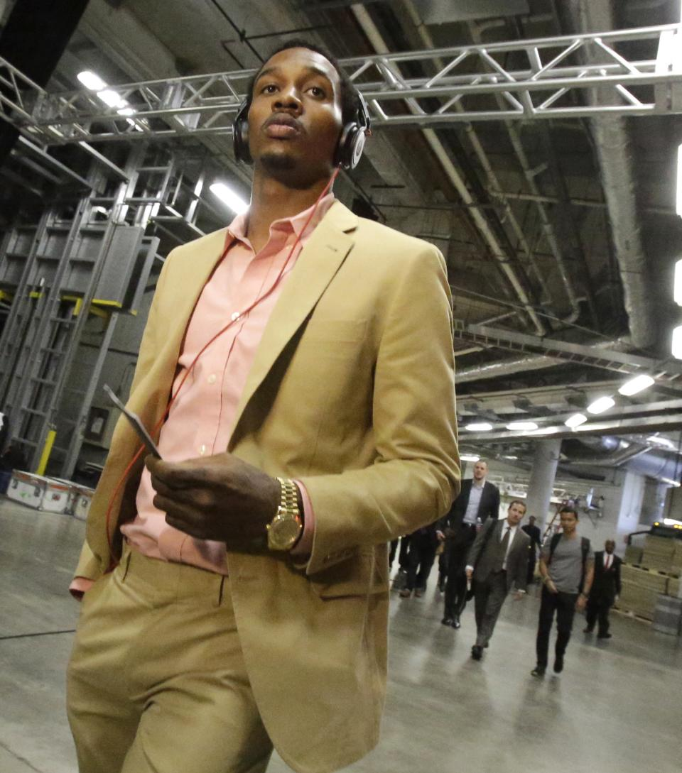 Milwaukee Bucks point guard Brandon Jennings arrives at AmericanAirlines Arena for Game 1 of their first-round NBA basketball playoff series against the Miami Heat in Miami, Sunday, April 21, 2013. (AP Photo/Alan Diaz)