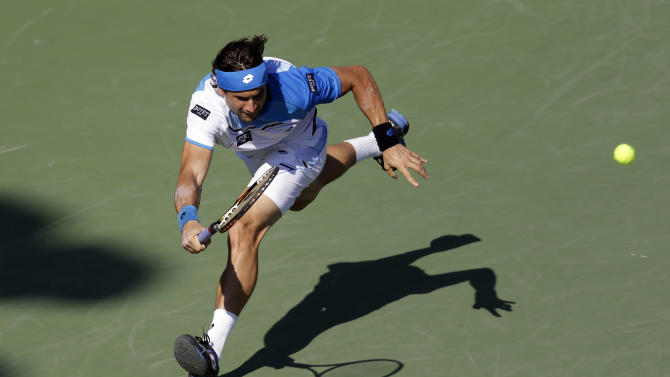 David Ferrer, of Spain, returns to Jurgen Melzer, of Austria, during the quarterfinals of the Sony Open tennis tournament, Wednesday, March 27, 2013, in Key Biscayne, Fla. (AP Photo/Lynne Sladky)