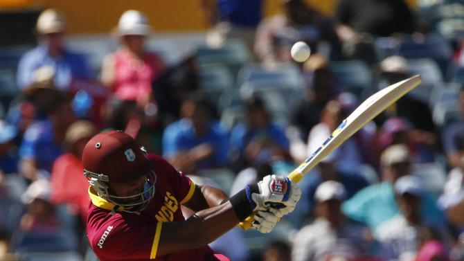 West Indies batsman Dwayne Smith hits a high ball during his Cricket World Cup match against India in Perth