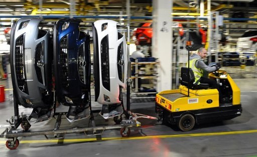 <p>Parts for Vauxhall and Opel Astra cars are transported on the production line at the Vauxhall factory in Ellesmere Port, north-west England. The Bank of England on Wednesday cut its forecast for UK economic growth next year to about 1% owing to the sovereign debt crisis in the neighbouring eurozone.</p>