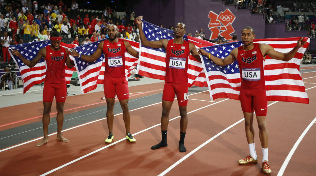 From left, United States' Tony McQuay, Angelo Taylor, Joshua Mance, and Bryshon Nellum, celebrate their silver medal in the men's 4x400-meter during the athletics in the Olympic Stadium at the 2012 Summer Olympics, London, Friday, Aug. 10, 2012. (AP Photo/Matt Dunham)
