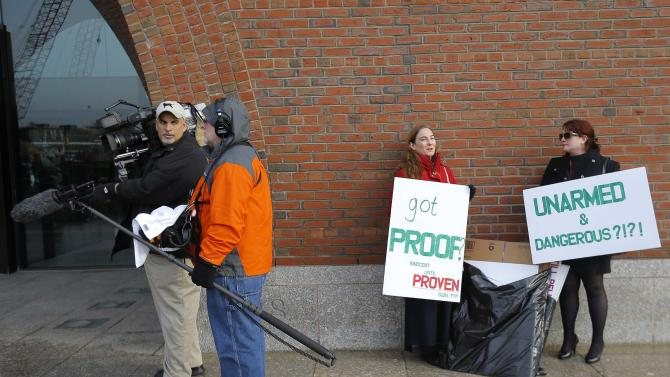 Demonstrators asserting that evidence of the Boston Marathon bombing was fabricated stand outside the federal courthouse ahead of a pre-trial conference for Boston Marathon bombing suspect Dzhokhar Tsarnaev in Boston