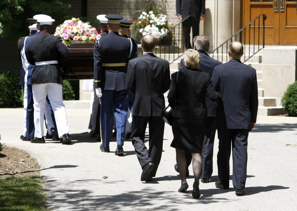 Members of the Ford family, Mike Ford, Jack Ford, Susan Ford Bales and Steve Ford, right, follow as the casket bearing the body of former first lady Betty Ford is carried by members of the armed forces into Grace Episcopal Church in Grand Rapids, Mich., Thursday, July 14, 2011. (AP Photo/Kiichiro Sato)