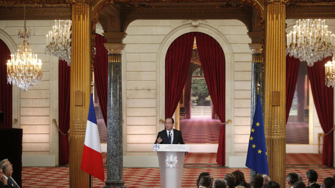 French President Francois Hollande gestures during a press conference at the Elysee Palace in Paris, Thursday, May 16, 2013. The European Union statistics office said Wednesday that nine of the 17 EU countries that use the euro are in recession, with France a notable addition to the list. (AP Photo/Christophe Ena)