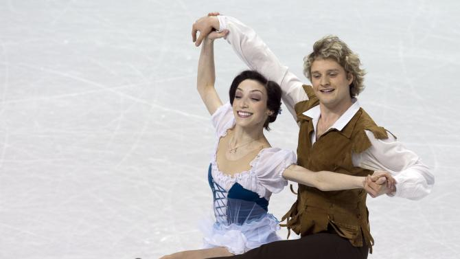 Meryl Davis and Charlie White, of the United States, perform in the ice dance short program at the World Figure Skating Championships, Thursday, March 14, 2013, in London, Ontario. (AP Photo/The Canadian Press, Frank Gunn)