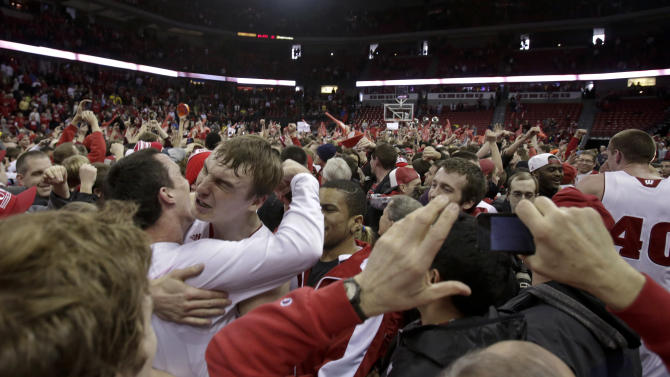 Wisconsin's Sam Dekker, facing camera at left, celebrates with teammate Dan Fahey after Wisconsin defeated Michigan 65-62 in an NCAA college basketball game Saturday, Feb. 9, 2013, in Madison, Wis. (AP Photo/Andy Manis)