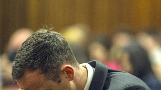 South African paralympic athlete Oscar Pistorius rests his head on October 17, 2014 during his sentencing hearing at the North Gauteng High Court in Pretoria