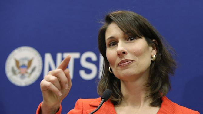 """National Transportation Safety Board Chairman Deborah Hersman points to a reporter during a news conference at the NTSB in Washington, Thursday, Jan. 24, 2013. The Boeing 787 Dreamliner battery that caught fire earlier this month in Boston shows evidence of short-circuiting and a chemical reaction known as """"thermal runaway,"""" in which an increase in temperature causes progressively hotter temperatures, federal accident investigators said. -It's not clear to investigators which came first, the short-circuiting or the thermal runaway, Hersman said. Nor is it clear yet what caused either of them, she said. (AP Photo/Manuel Balce Ceneta)"""