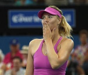 Sharapova of Russia blows a kiss to the crowd after her win against Kanepi of Estonia during their women's singles match at the Brisbane International tennis tournament in Brisbane