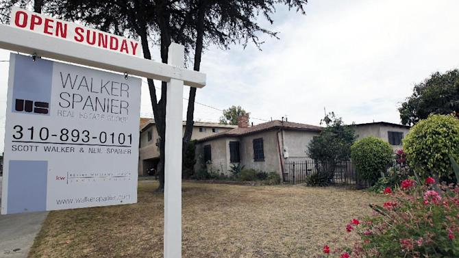 In this Tuesday, June 11, 2013, photo, a single house is offered for sale in Santa Monica, Calif. National Association of Realtors reports on sales of previously occupied homes in May Thursday June 20, 2013. (AP Photo/Nick Ut)
