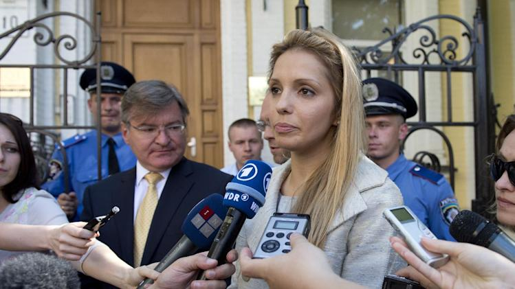 The daughter of former Ukrainian Prime Minister Yulia Tymoshenko, Eugenia Tymoshenko, gives a statement in Kiev Ukraine  Monday, June 11, 2012.  At left, former deputy Prime Minister  Hryhoriy Nemyria.  Two high-profile European Union representatives have come to Ukraine to monitor the legal cases against jailed former Prime Minister Yulia Tymoshenko.  Former European Parliament President Pat Cox and former Polish President Aleksander Kwasniewski will be watching proceedings against Tymoshenko, who has been sentenced to seven years in prison on charges of abuse of office and who faces other charges.  (AP Photo/dapd/ Nigel Treblin)