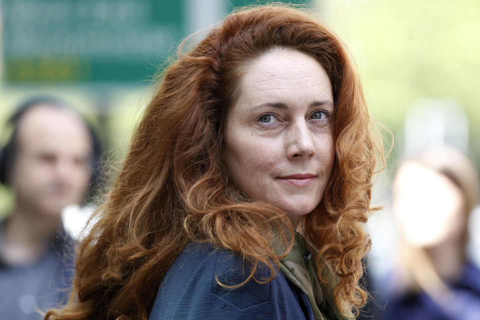 Rebekah Brooks, former chief executive of News International, leaves Westminster Magistrates' Courts on charges of attempting to cover up tabloid phone-hacking, London, Wednesday, June 13, 2012. (AP Photo/Sang Tan)