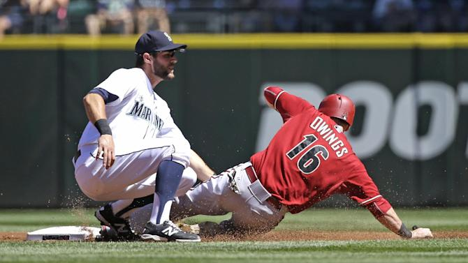 Arizona Diamondbacks' Chris Owings (16) slides into a tag by Seattle Mariners shortstop Chris Taylor on a stolen base attempt in the second inning of a baseball game Wednesday, July 29, 2015, in Seattle. (AP Photo/Elaine Thompson)