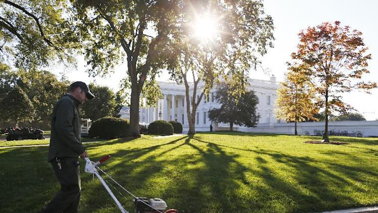 A National Park Service employee uses an edge trimmer as workers tend to the North Lawn of the White House in Washington, Friday, Oct. 18, 2013, after a 16-day partial government shutdown was resolved by lawmakers late Wednesday. (AP Photo/Charles Dharapak)