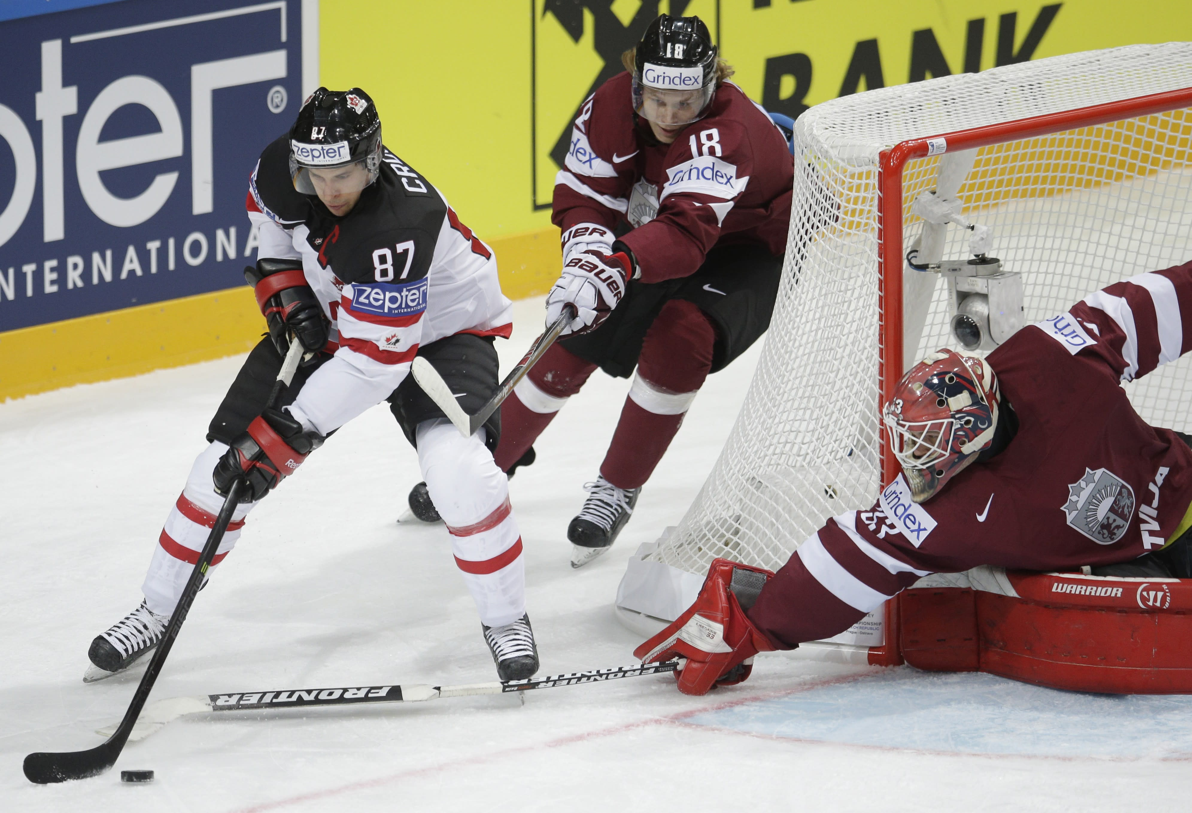 Canada opens hockey worlds with 6-1 win over Latvia