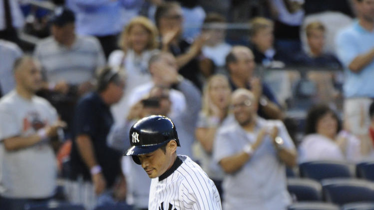New York Yankees' Ichiro Suzuki rounds the bases with a three-run home run during the third inning of a baseball game against the Toronto Blue Jays Friday, July 25, 2014, at Yankee Stadium in New York. (AP Photo/Bill Kostroun)