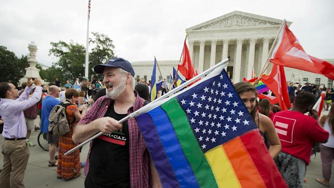 FILE - In this June 26, 2015 photo, supporters celebrate outside the Supreme Court in Washington, Friday, June 26, 2015 after the court declared that same-sex couples have a right to marry anywhere in the United States. It was 2004 when Massachusetts became the first state to allow same-sex couples to marry. Eleven years later, the Supreme Court has now ruled that all those gay marriage bans must fall and same-sex couples have the same right to marry under the Constitution as everyone else. (AP Photo/Manuel Balce Ceneta)