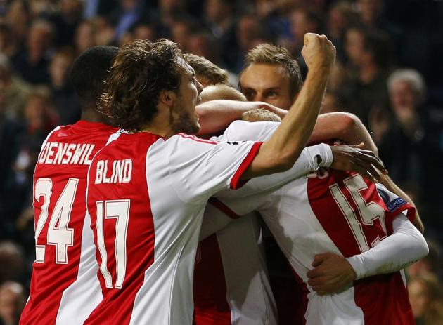 Ajax Amsterdam's Schone celebrates his goal against Celtic during their Champions League soccer match at Amsterdam Arena