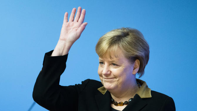 German Chancellor and chairwoman of the Christian Democratic Party (CDU) Angela Merkel waves to the delegates as she arrives at the party's 2012 convention in Hannover, Tuesday, Dec. 4, 2012. The ruling CDU will elect a new board and reelect Angela Merkel as the party's chairwoman at the convention. (AP Photo/Markus Schreiber)