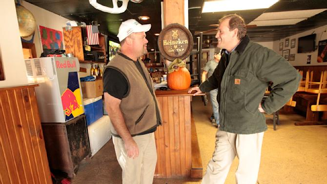 Andy Barr, the Republican nominee for U.S. Congress in Kentucky's 6th District, visits with Yount's Tavern owner, Danny Thomas in Midway, Ky., on Monday Nov. 5, 2012. Barr is running against incumbent U.S. Rep. Ben Chandler, D-Versailles for   (AP Photo/The Lexington Herald-Leader, Pablo Alcala)