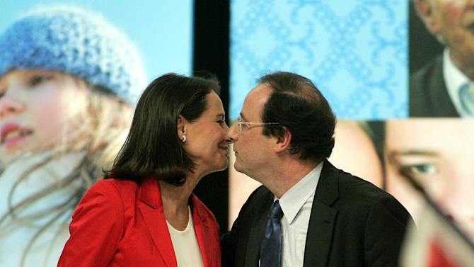"""FILE - Socialist French presidential candidate Segolene Royal, left, kisses her partner Secretary-General of the Socialist Party Francois Hollande during a meeting in Limoges, central France, in this file photo dated Thursday March 29, 2007.  According to reports on Friday July 13, 2012, French President Fancois Hollande is widely expected to break his silence about """"tweetgate"""", the alleged family feud involving the mother of his children Segolene Royal, his eldest son Thomas and his current companion Valerie Trierweiler, that has riveted the media and the Internet, during a television interview to be broadcast Saturday July 14, 2012. (AP Photo/Michel Euler, file)"""