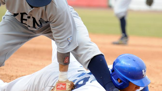 Kentucky base runner Austin Cousino slides back into first as Kent State first baseman George Roberts attempts a tag during an NCAA college baseball tournament regional game in Gary, Ind., Friday, June 1, 2012. (AP Photo/Joe Raymond)