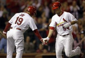 Cards top Reds 4-2, clinch tie for 2nd wild card