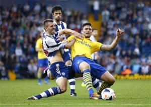 Arsenal's Olivier Giroud challenges West Bromwich Albion's Gareth McAuley during their English Premier League soccer match in West Bromwich